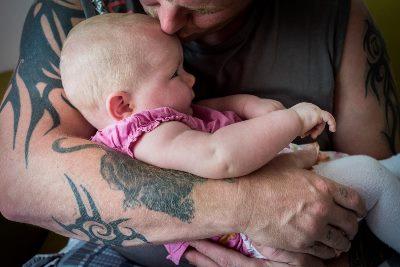 Baby op arm